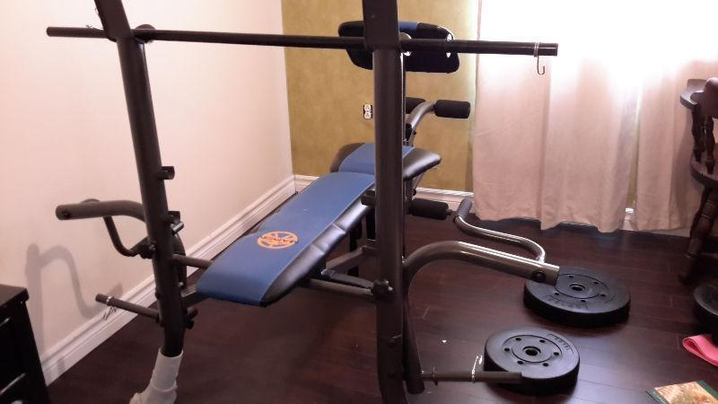 workout bench with barbell and weights
