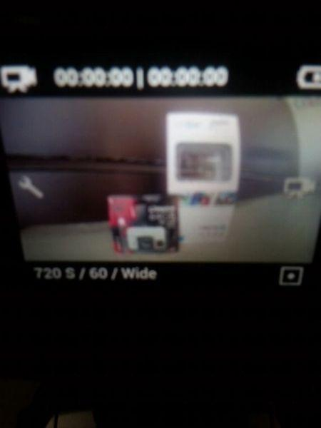 Go Pro +Lcd & 64 g micro sd with adaptor both brand new