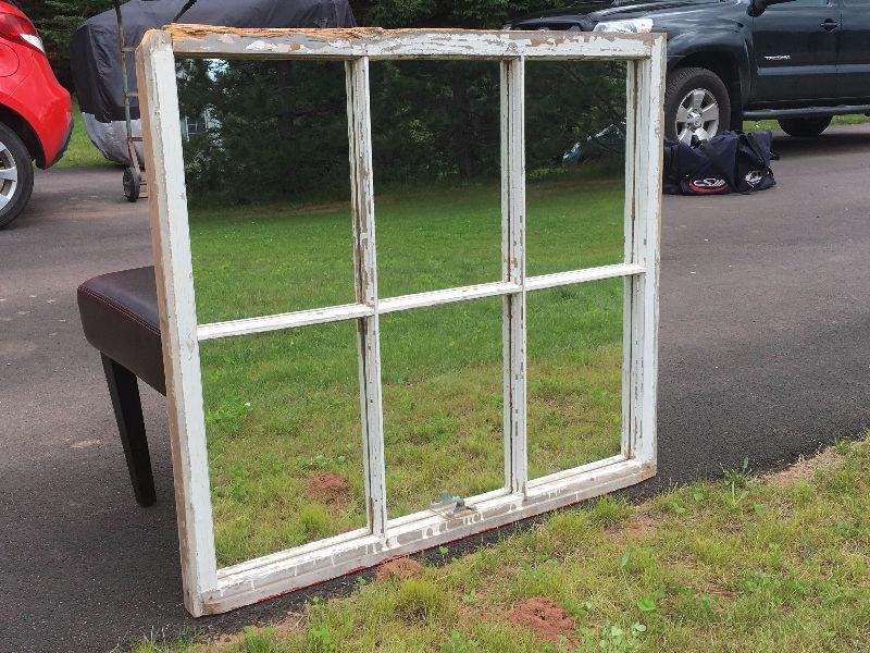 Large antique window frame with mirrors