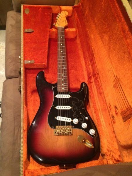 Fender SRV signature Strat as new with tweed case and candy